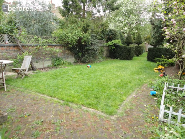 Garden before with overgrown brick paths