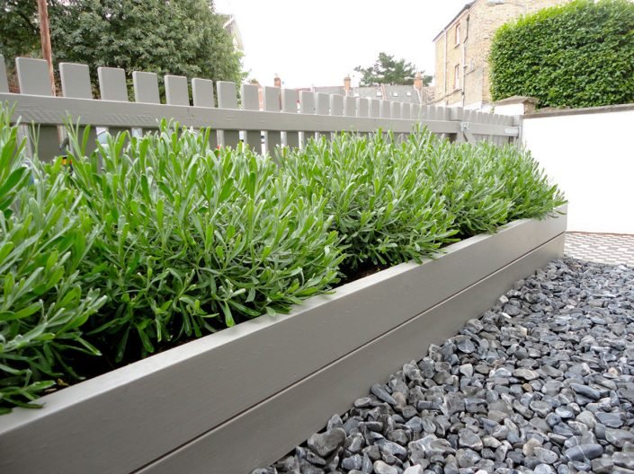 Painted timber picket fence & raised bed – Garden Design by Antonia Schofield