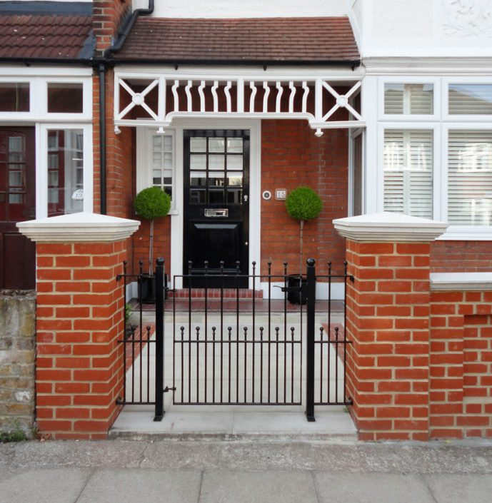 Iron gate with matching glossy black front door