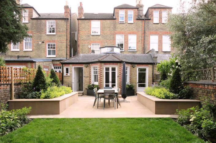 Classic sandstone terrace and raised beds by Antonia Schofield, Garden designer
