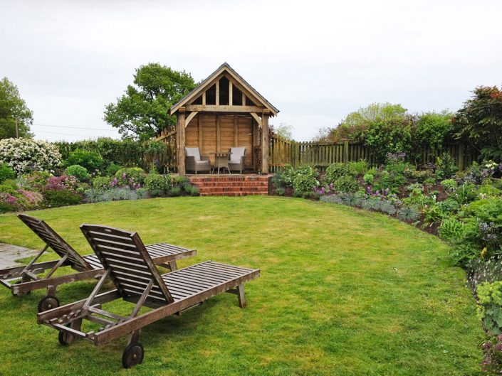 Country garden with green oak gazebo by Antonia Schofield, Garden designer