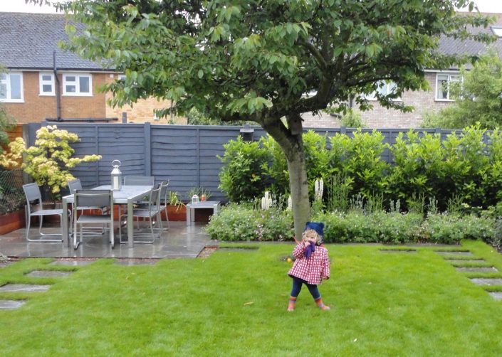 Ample lawn for playing – Garden Design by Antonia Schofield